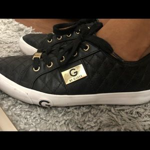 Black lace up sneakers by Guess